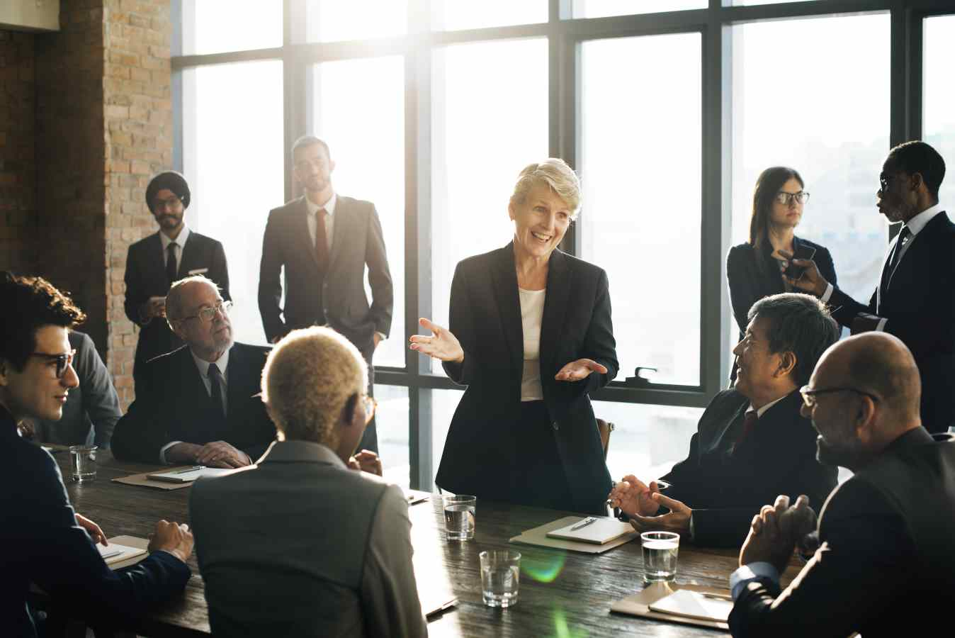 woman presenting to room of other business people